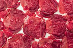 Thin Slices of Meat to form a Background with Raw food Pattern Royalty Free Stock Photo