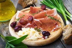 Thin slices of prosciutto with  pecorino Royalty Free Stock Photos