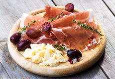 Thin slices of prosciutto with  pecorino Stock Images