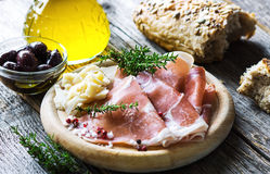 Thin slices of prosciutto with  pecorino Royalty Free Stock Images