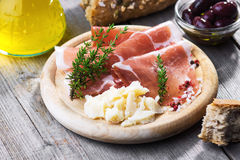 Thin slices of prosciutto with  pecorino Stock Image