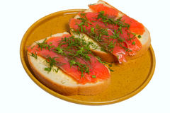 Thin slices of red fish lie on white bread Royalty Free Stock Photos
