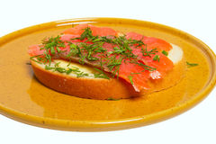 Thin slices of red fish lie on white bread Royalty Free Stock Photography