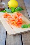 Thin slices of salmon fillet Royalty Free Stock Photos