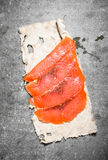 Thin slices of salmon on the old fabric. Royalty Free Stock Images