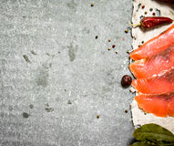 Thin slices of salmon on the old fabric. Stock Images
