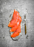 Thin slices of smoked salmon with a fork. Royalty Free Stock Photography