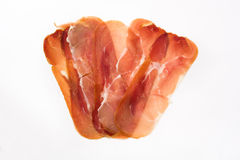 Thin slices of spanish serrano ham isolated on white background Stock Images