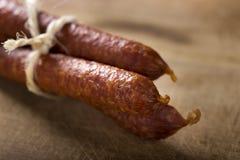 Thin smoked sausage Royalty Free Stock Photo