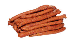 Thin smoked sausage on white background. Many thin smoked sausage on white background Royalty Free Stock Photo