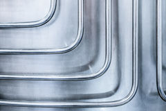 Thin steel tubes curved at right angles. Royalty Free Stock Photo