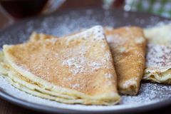 Thin sweet pancakes with powdered sugar for Breakfast Stock Photos