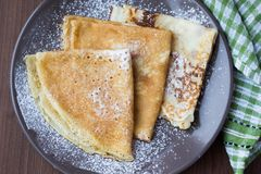 Thin sweet pancakes with powdered sugar for Breakfast Royalty Free Stock Photography