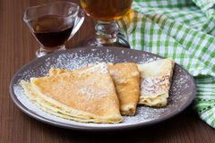 Thin sweet pancakes with powdered sugar for Breakfast Stock Images
