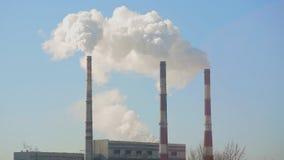 Thin tube power plants emit smoke stock video footage