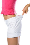 Thin waist woman in big shorts Stock Photos
