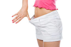 Thin waist woman in big shorts Royalty Free Stock Images
