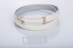 Thin white female belt buckle with fine Stock Images