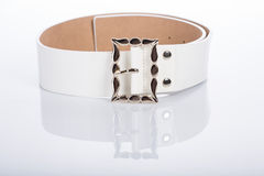 Thin white female belt buckle with fine Stock Photography
