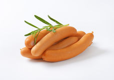 Thin wiener sausages. With rosemary on white background Stock Image