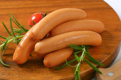 Thin wiener sausages. On wooden cutting board - close up Stock Photos