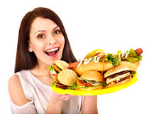 Thin woman holding hamburger. stock photo