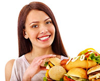 Thin woman holding hamburger. Royalty Free Stock Photo