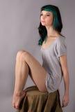 Thin Woman on Stool Royalty Free Stock Photos