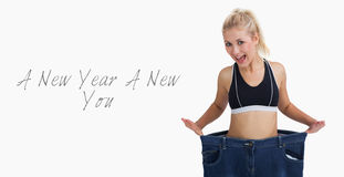 Thin woman wearing old pants after losing weight Royalty Free Stock Photos