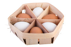 Thin wood egg box with six eggs Stock Photo