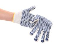 Thin work glove with blue pimple. Isolated on a white background royalty free stock photo