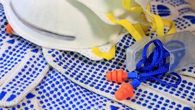 Thin work gloves with blue pimples, respirators and ear plugs on a rotating surface, stock video footage