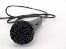 Is this thing on?. Studio microphone isolated on a white background with cord trailing off to the side Stock Image