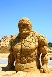 The Thing from fantastic four movie. Sand sculpture of The Thing from fantastic fou movie isolated on a clear blue sky made in city of Burgas (Bulgaria) ,during stock image