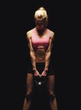 This Thing Is So Heavy!. Fitness woman doing a weight training by lifting a heavy kettlebell Royalty Free Stock Image