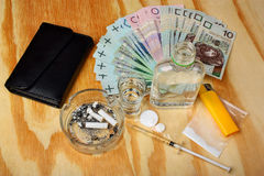 Things bandit criminal drug, boosters dealer polish money on the table Stock Images