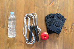 Things and food on the floor for sports hall. Lay things sports and apple Stock Photography