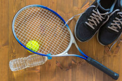 Things for the game of tennis on the floor Royalty Free Stock Photography
