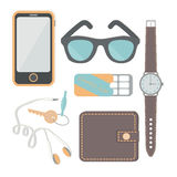 Things a man carries with him: a watch, a phone, headphones, keys, wallet, chewing gum, sunglasses, headphones. Stock Image