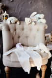 Things for the newborn baby lie on the chair. royalty free stock photos
