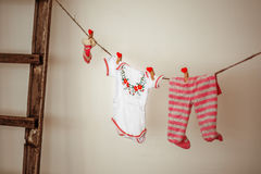 Things for the newborn hanging on rope Royalty Free Stock Photo