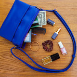 Things from open lady handbag. Royalty Free Stock Photos