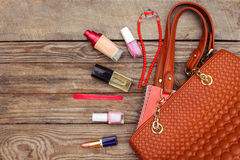Things from open lady handbag. Royalty Free Stock Image