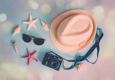Things for summer holidays. Hat, sunglasses, photo camera, starfishes and seashells. On blue background. Top view stock images