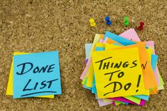 Things to do done list notes. Sticky postit note paper push pins stick pin things to do home list message motivation blue yellow done cork board royalty free stock image