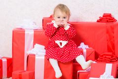 Things to do with toddlers at christmas. Christmas gifts for toddler. Gifts for child first christmas. Celebrate first. Christmas. Little baby girl play near royalty free stock photo
