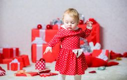Things to do with toddlers at christmas. Little baby girl play near pile of gift boxes. Family holiday. Christmas. Activities for toddlers. Christmas miracle stock photos