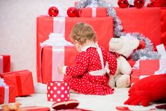 Things to do with toddlers at christmas. Little baby girl play near pile of gift boxes. Family holiday. Gifts for child. First christmas. Christmas activities stock image