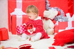 Things to do with toddlers at christmas. Little baby girl play near pile of gift boxes. Family holiday. Gifts for child. First christmas. Christmas activities royalty free stock photography