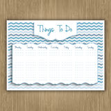Things to do weekly planner. On a wood texture background Royalty Free Stock Photo